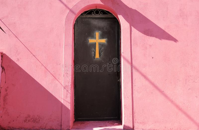 Golden cross on a metal door royalty free stock photos