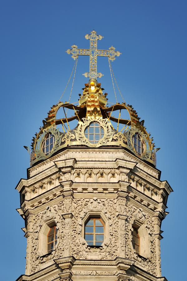 Golden Crown With Cross of Dubrovitsy Church Against Blue Sky. MOSCOW, RUSSIA - The top of the Church of the Virgin of the Sign in Dubrovitsy decorated by a stock photo