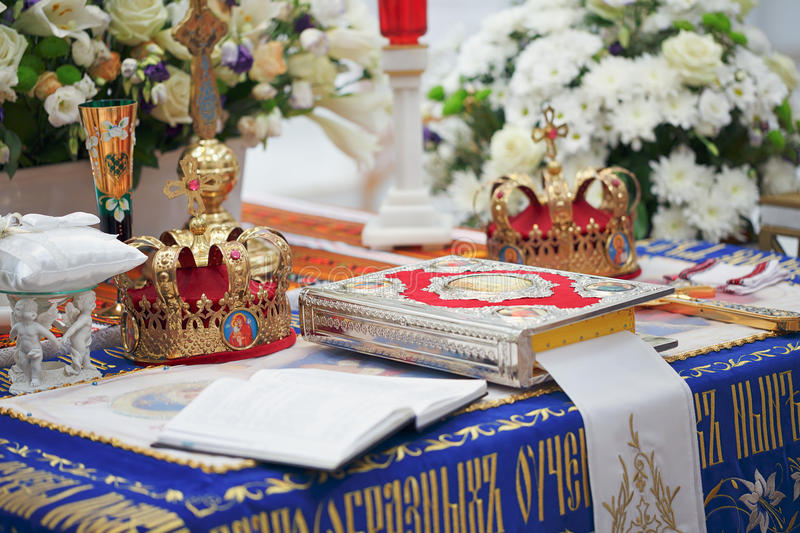 Golden crowns for wedding ceremony. Church supplies and Golden crowns for wedding ceremony in the Orthodox Church royalty free stock photo