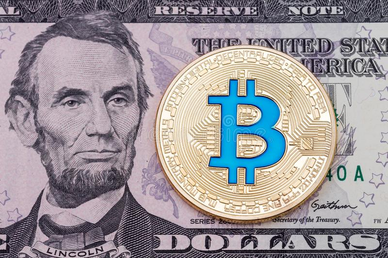 Golden cruptocurrency blue bitcoin on dollar banknote background royalty free stock photos
