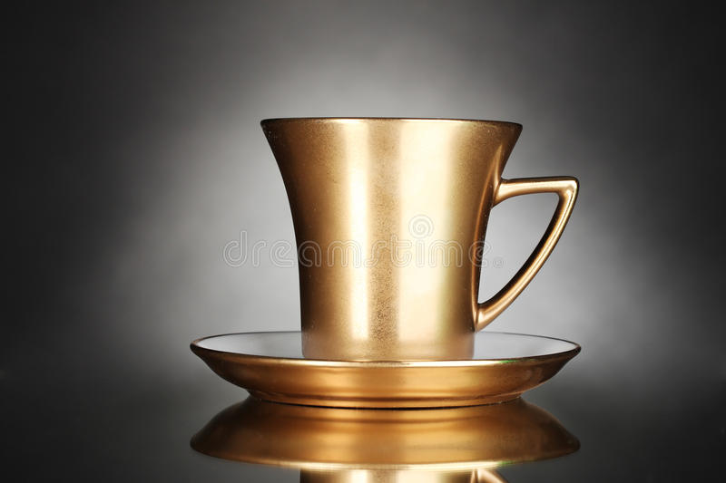 Golden cup of coffee