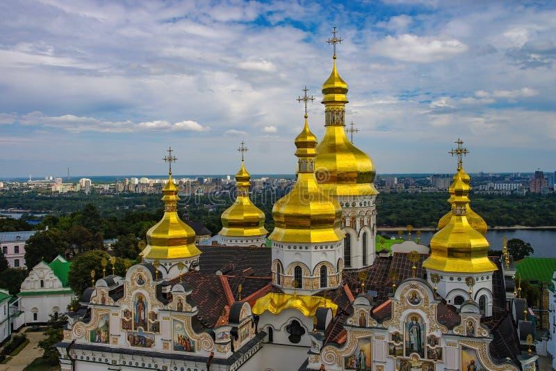 Golden cupolas of Dormition Cathedral in Kyiv Pechersk Lavra monastery, Kyiv, Ukraine. UNESCO World Heritage Site. Golden cupolas of Dormition Cathedral in Kyiv stock image