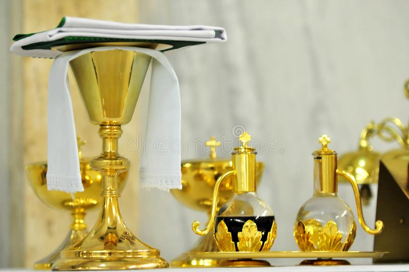Golden cups of celebration in the church royalty free stock images