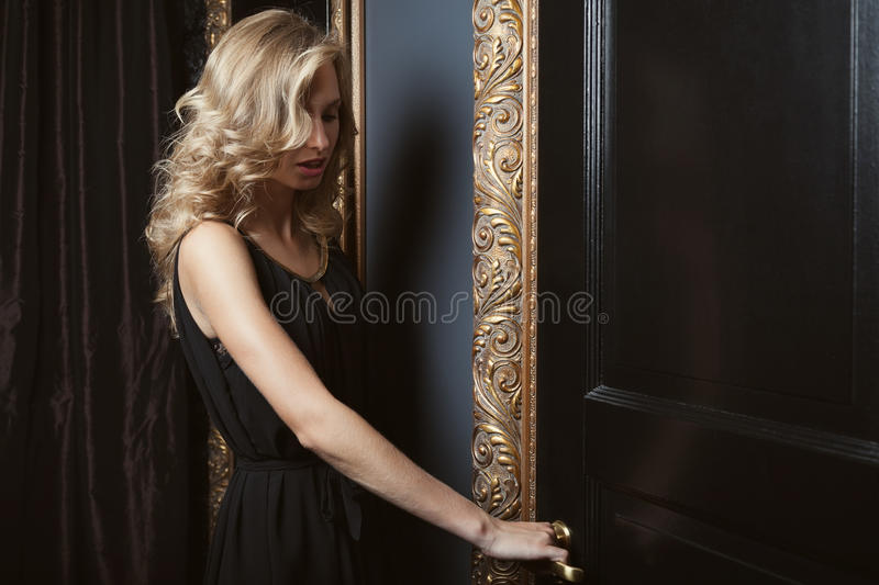 Golden curls. Beautiful woman with golden curls royalty free stock images