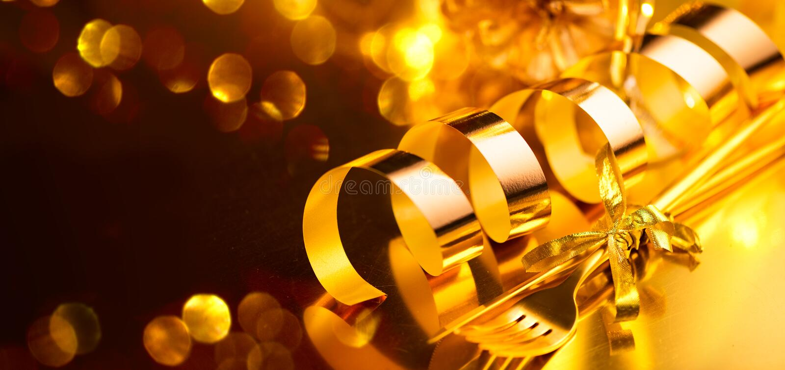Golden cutlery, luxury Christmas table settings. Table served for Christmas holiday dinner. Xmas and New Year stock image