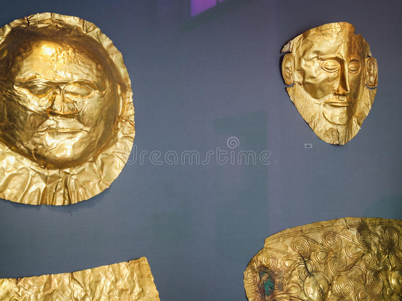 Golden death masks in Museum in Athens. ATHENS, GREECE - SEPTEMBER 12, 2007: golden death masks in National Archaeological Museum in Athens. The museum is house stock photography