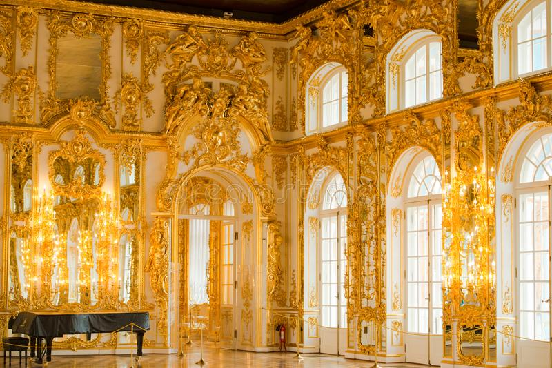 Golden decoration in ballroom of roccoco palace Catherine Palace,  located in the town of Tsarskoye Selo or Pushkin St. Petersburg royalty free stock images