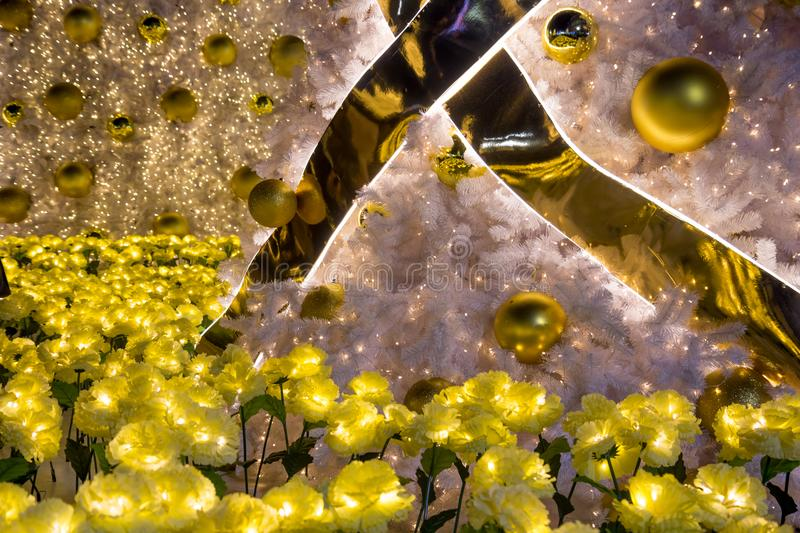 Golden decoration on a Christmas tree stock image