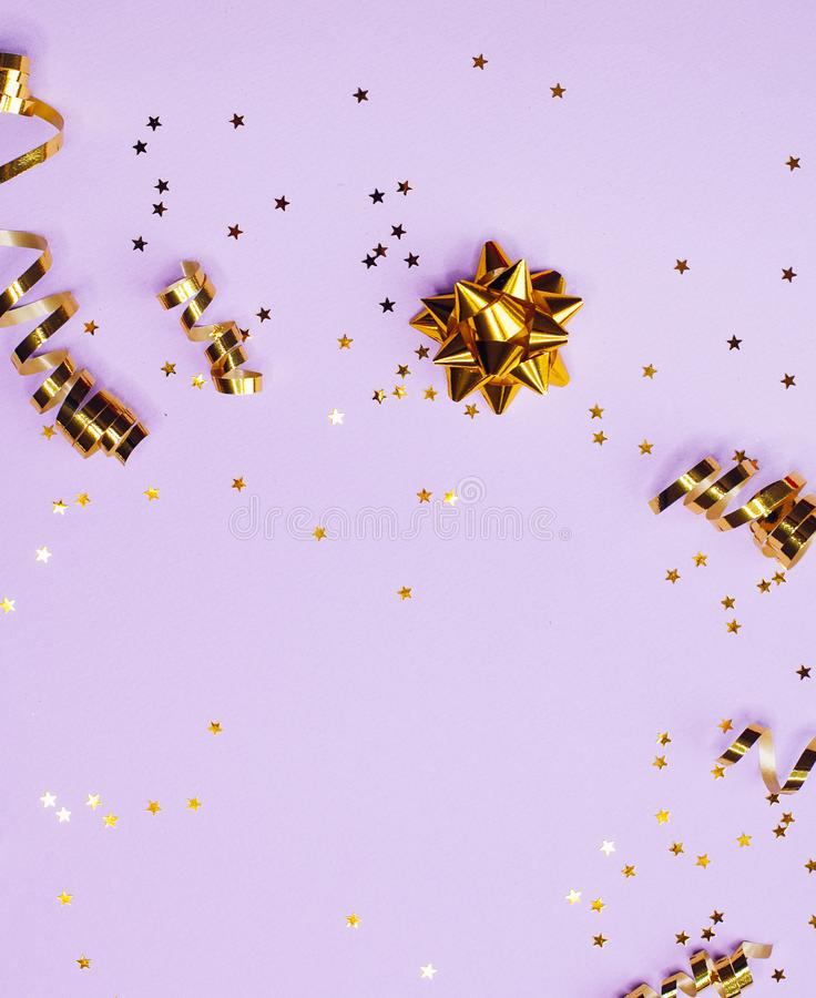 Golden decorations and sparkles on pale purple background. Golden decorations and sparkles on bright  pale purple background stock photography