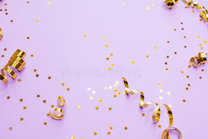 Golden decorations and sparkles on pale purple background. Golden decorations and sparkles on bright  pale purple background stock images