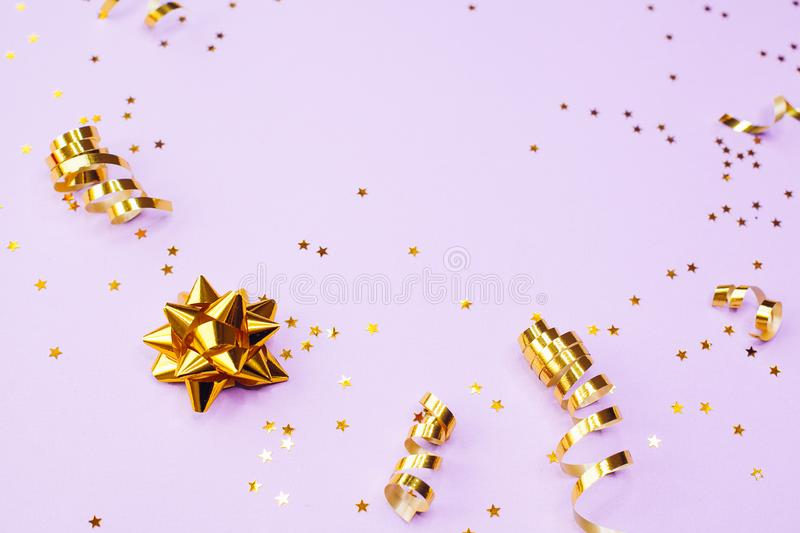 Golden decorations and sparkles on pale purple background. Golden decorations and sparkles on bright  pale purple background royalty free stock images