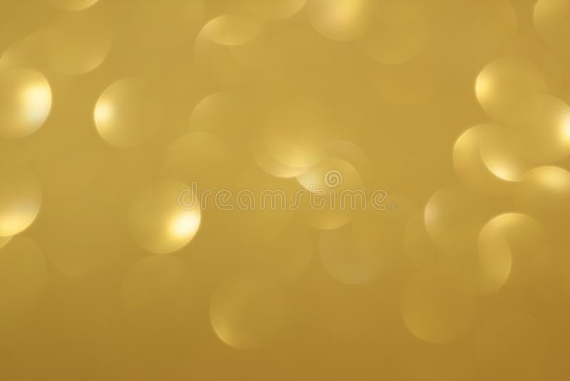 Golden defocused flickering lights for text and background.  stock images