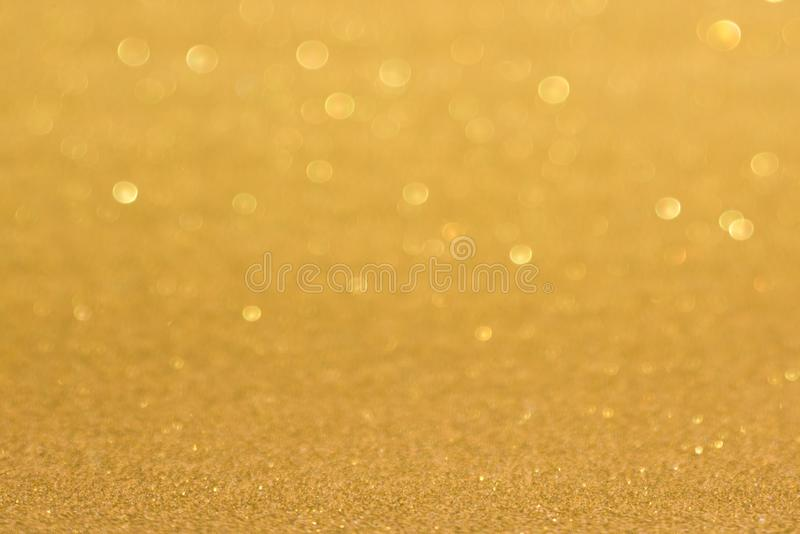 Golden defocused flickering lights for text and background.  royalty free stock photo