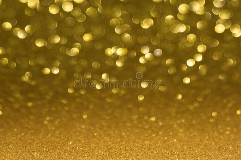 Golden defocused flickering lights for text and background.  royalty free stock images