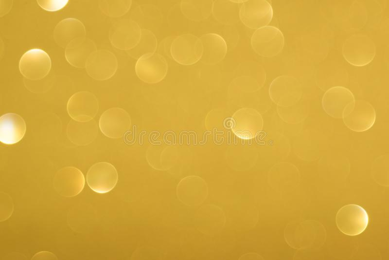 Golden defocused flickering lights for text and background.  stock photos