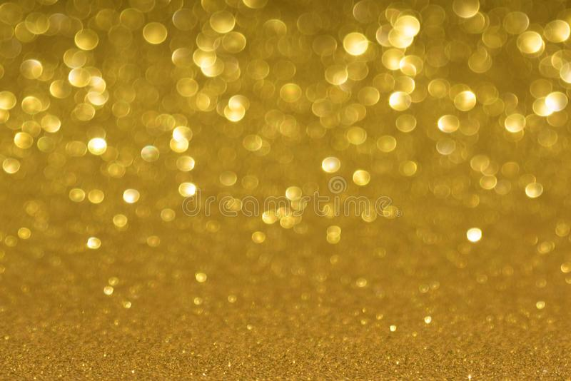 Golden defocused flickering lights for text and background.  royalty free stock photography