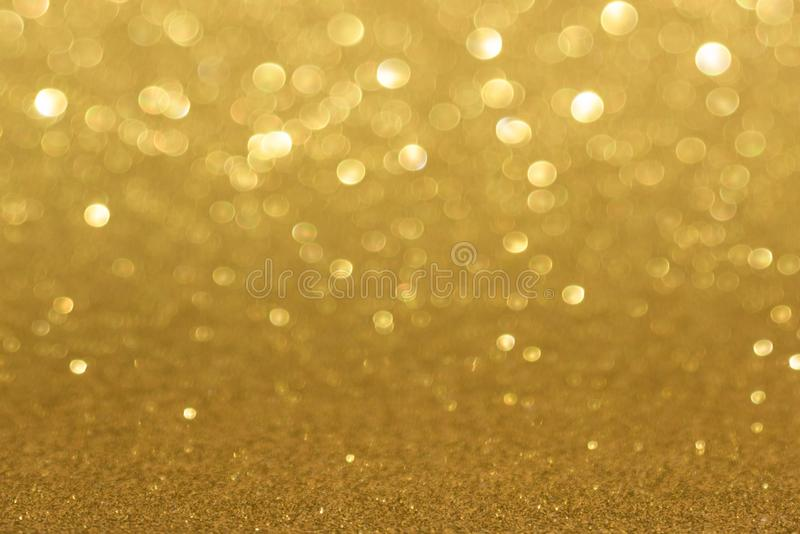 Golden defocused flickering lights for text and background.  stock image