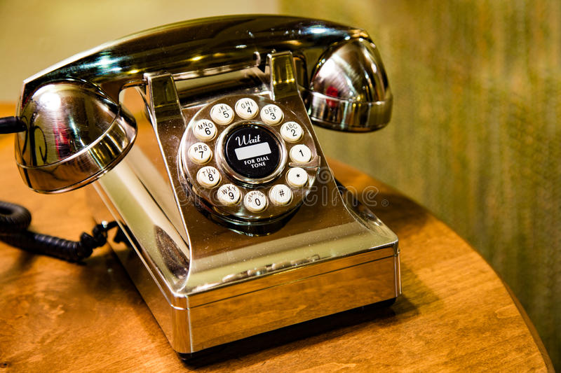 Golden desk phone. A gleaming gold telephone waiting for you to contact us, or just placed there for customer service stock photos