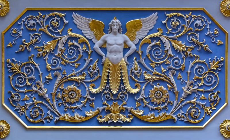 Golden detail of the ornate ceiling in the Hermitage museum of art and culture in Saint Petersburg, Russia in the Winter Palace stock photography