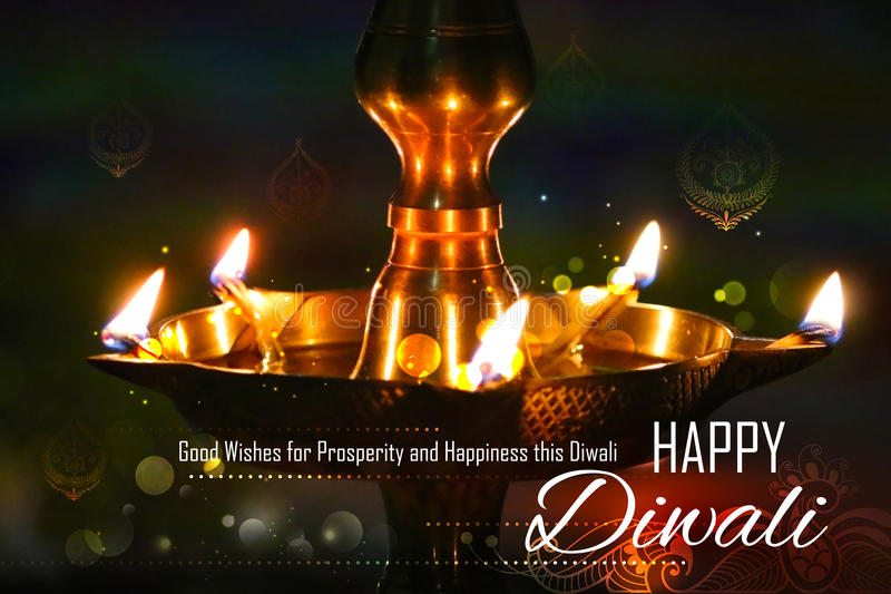Golden diya stand on abstract Diwali background royalty free stock image