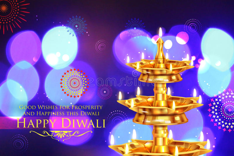 Golden diya stand on abstract Diwali background stock images