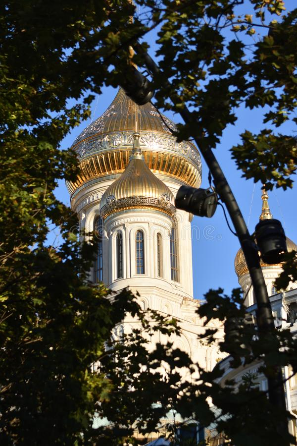 Golden dome of the church among the foliage stock images
