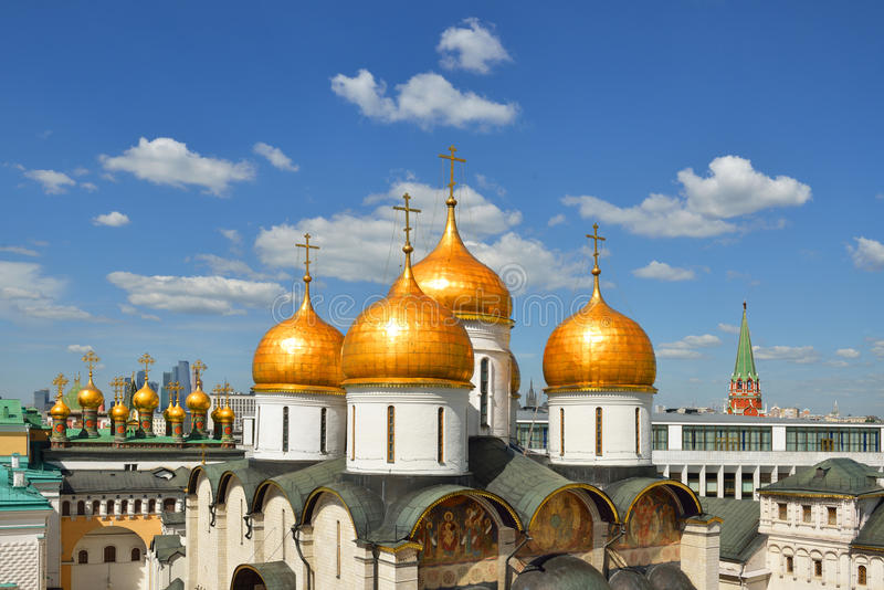 Golden domes of Cathedrals of Moscow Kremlin on blue sky background stock photography
