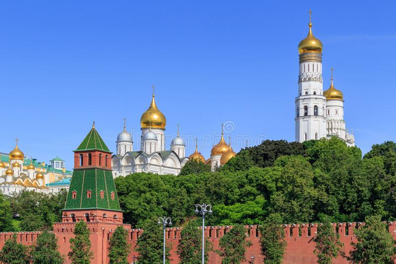Golden domes of churches in Moscow Kremlin on a blue sky background in sunny summer morning royalty free stock photos