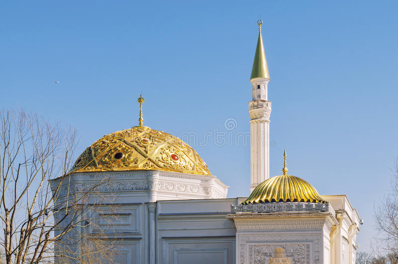 The golden domes of The Turkish Bath pavilion in the Catherine Park. royalty free stock photography