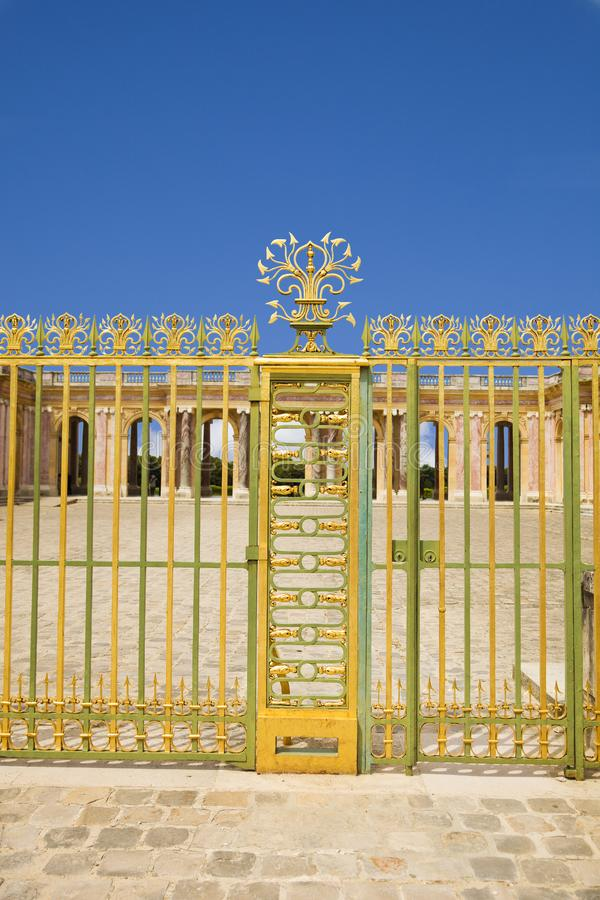 Golden door at entrance of Le Grand Trianon royalty free stock photography