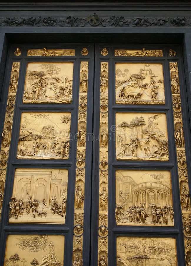Golden doors of duomo stock photography