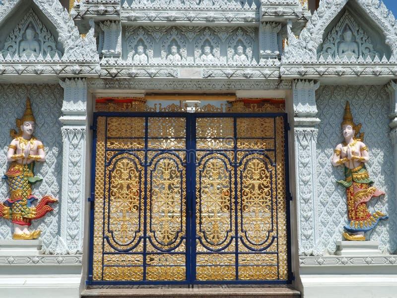 Golden doors at Thai temple stock image