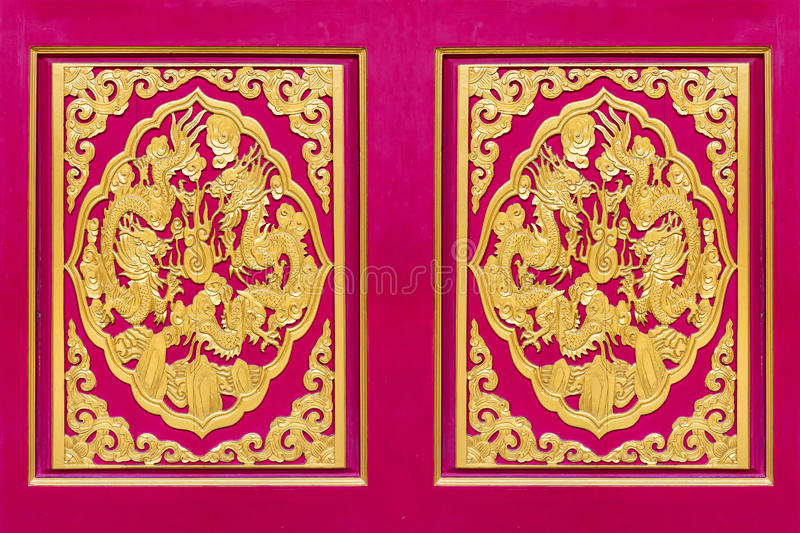 Golden dragon carved decorated on red wooden door. Chinese style in Chinese temple,Thailand. The public domain or treasure of Buddhism, no restrict in copy or stock photos