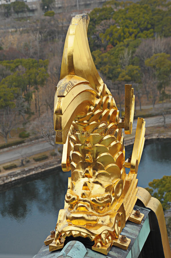Golden dragon on roof of osaka castle royalty free stock image
