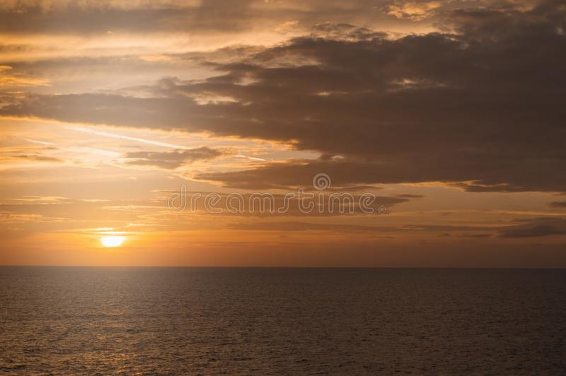 Golden dramatic sunset over the Mediterranean sea, beautiful natural background, tranquility and harmony in nature, the concept of stock photo