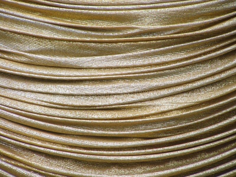 Golden Drape. Gold frabric drape royalty free stock photo