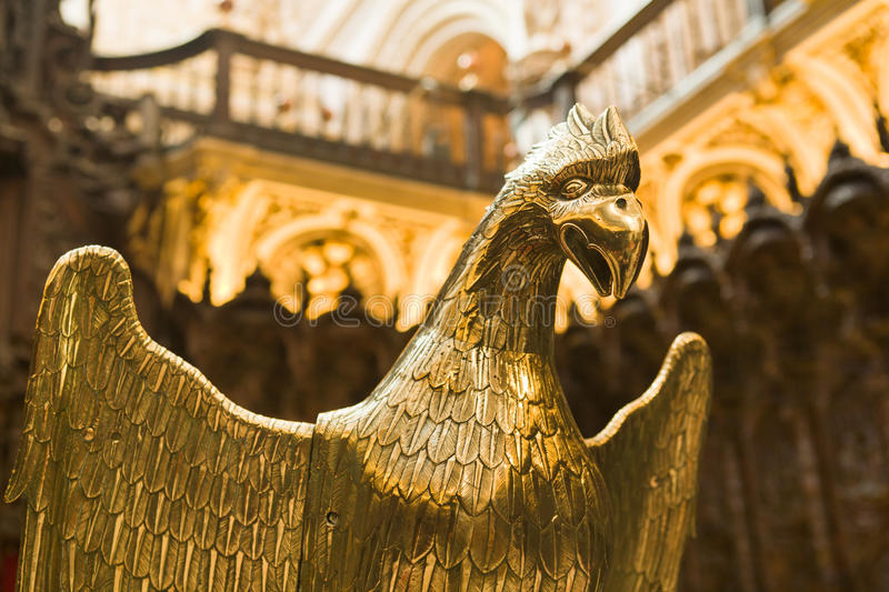 Golden eagle on pulpit. Pulpit with golden eagle, Cathedral of Cordoba, Spain stock images