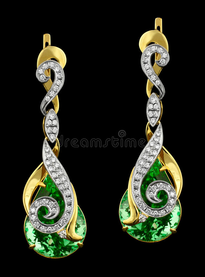 Golden earrings with diamonds and gem royalty free stock image