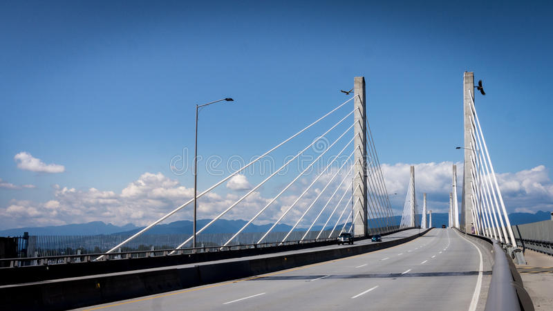 Golden Ears Bridge in the Fraser Valley. The Golden Ears Bridge over the Fraser River connecting the towns of Langley and Maple Ridge in the Fraser Valley of royalty free stock photo
