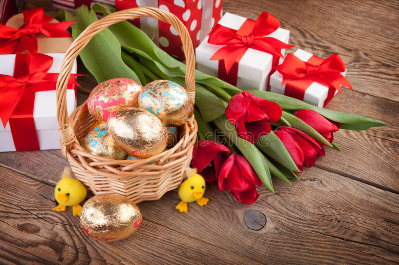Golden easter eggs flowers and gifts stock photo image of nest download golden easter eggs flowers and gifts stock photo image of nest luxury negle Image collections