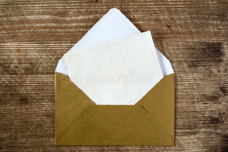 Golden envelope with blank letter. For your message royalty free stock photography