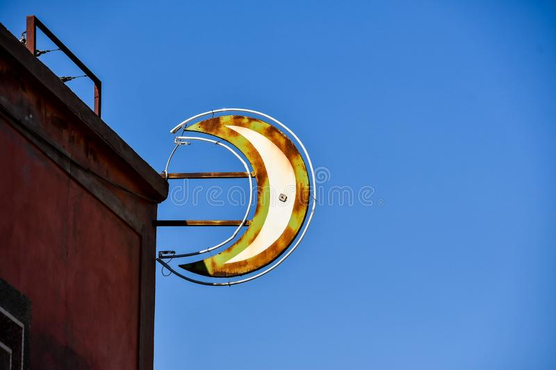 Golden euro sign on blue sky, photo as background. Golden euro sign on blue sky, beautiful photo digital picture stock images