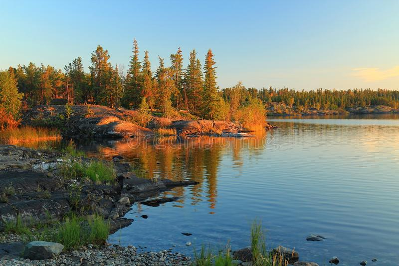 Golden Evening Light at Frame Lake near Territorial Assembly Building, Yellowknife, Northwest Territories royalty free stock photo