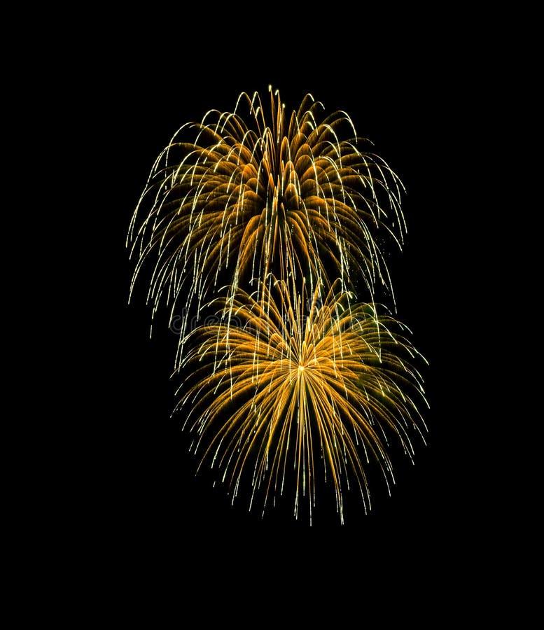 Golden exploded fireworks isolated on black background stock images