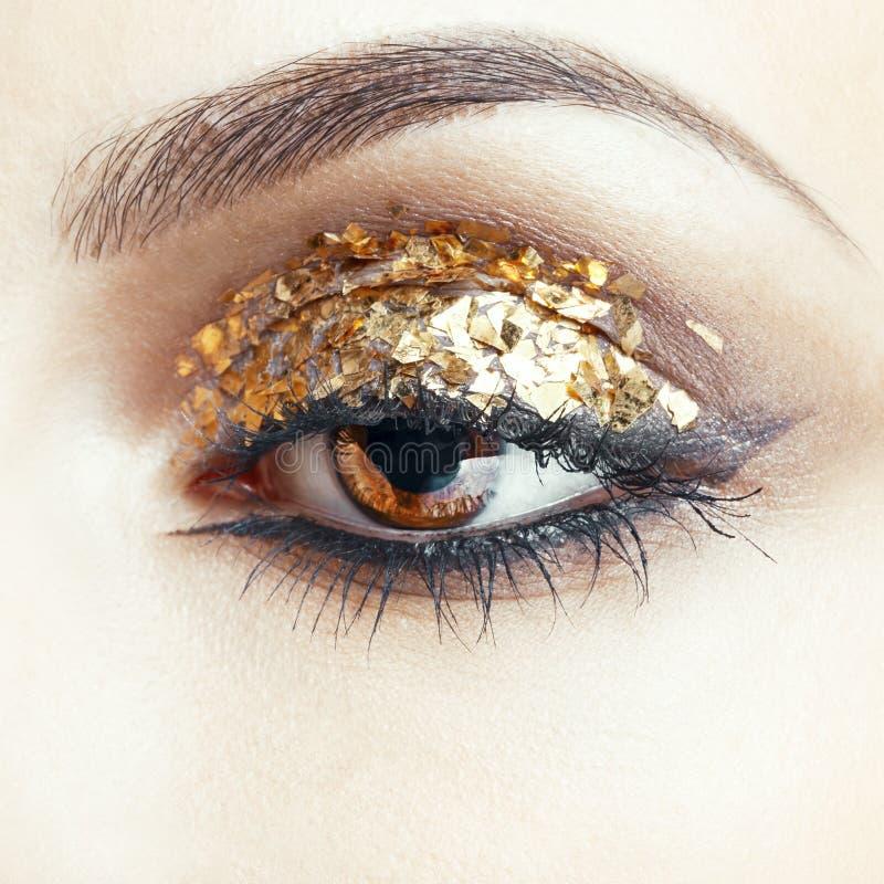 Golden eye makeup royalty free stock image