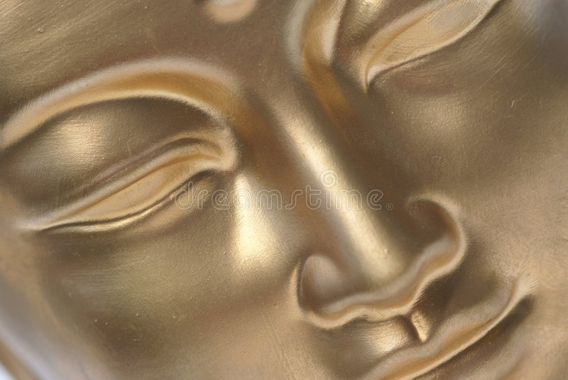 A golden face. stock images