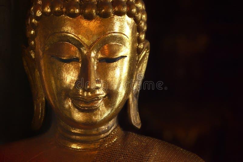 Golden face of buddish state in the art style ,Wat Krathum Suea Pla temple ,Bangkok stock photo