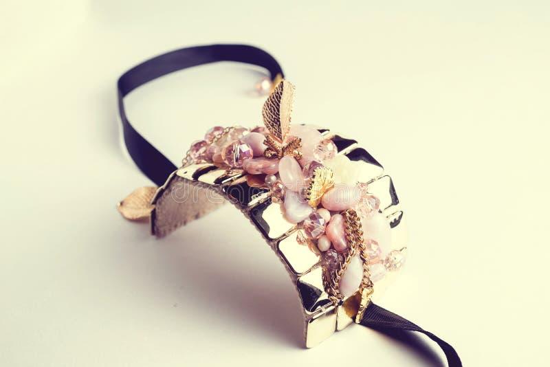 Golden fashion handmade bracelet on white royalty free stock photo