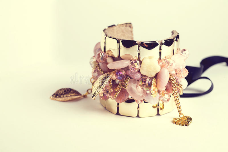 Golden fashion handmade bracelet on white stock photos
