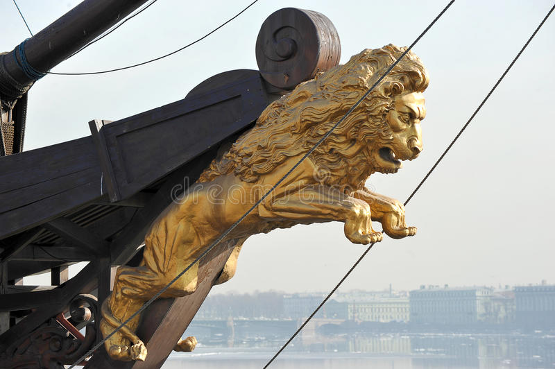 A Golden figure of a lion on the bow royalty free stock image